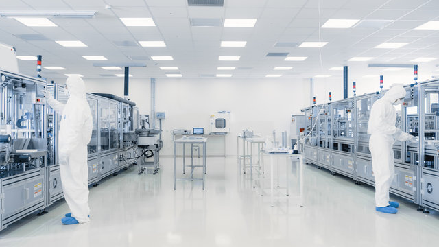 Scientists Working in Laboratory. Facility with Modern Industrial Machinery. Product Manufacturing Process: Pharmaceutics, Semiconductors, Biotechnology.