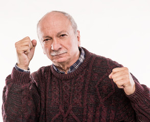 Elderly man threatening with a fists