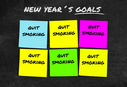handwritten 2019 New Year resolutions and goals in sticky notes in commitment determination about quit smoking giving up cigarettes and tobacco isolated on blackboard