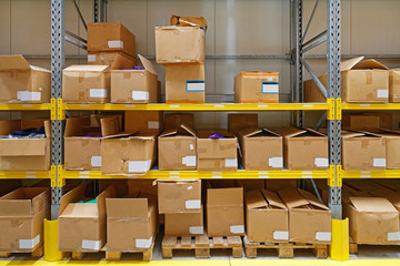Goods in Boxes at Shelf in Warehouse