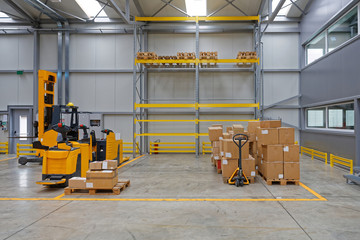 Forklift and Pallet Truck in Warehouse