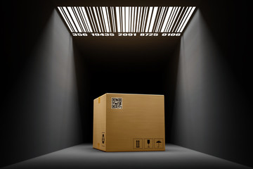 Packages delivery and automatic parcel processing system concept, cardboard box in a dark room in the light of a bar code