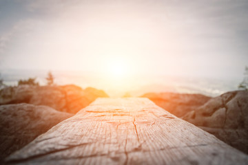 Wooden plank in front of the nature during the sunset.  Table background and spring time Wall mural