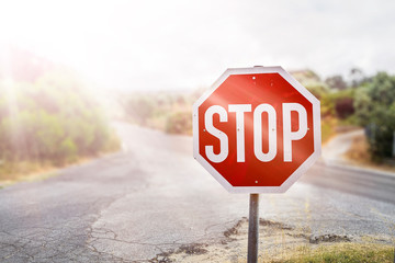 STOP warning traffic sign on a road