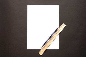 white background with ruler and pencil for lettering