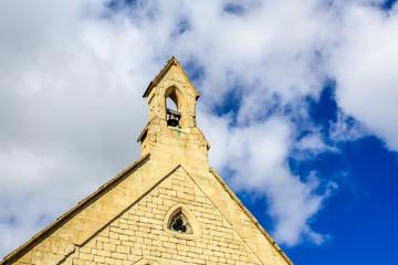 Church roof against a cloudy sky