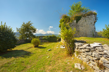 Ruins of the former castel of Montousse with Pyrenees on bacground