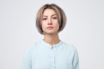 Passport photo. Portrait of european young woman in blue shirt