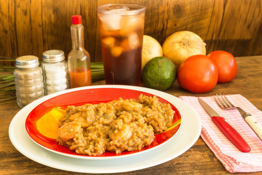 Shrimp Etouffee Dinner on Red Plate in Rustic Wooden Table