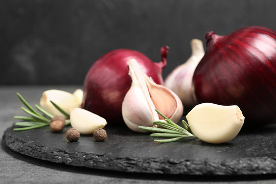 Composition with garlic and onion on slate plate