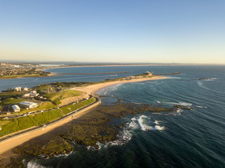 Aerial Photos of Nobby's Beach and Nobby's Lighthouse at Newcastle, New South Wales in Australia