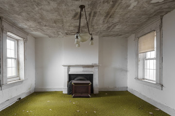Green carpet in empty room of abandoned house