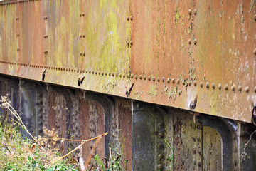 old rusted metal riveted panels