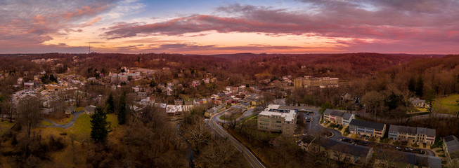 Sunset aerial panorama of Historic Old Ellicott City Maryland, USA typical civil war era small town with the oldest train station, rebuilding after deadly floods