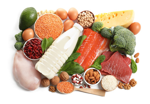 Set of natural food high in protein on white background, top view