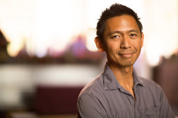 Portrait of a healthy middle age Asian man smiling.