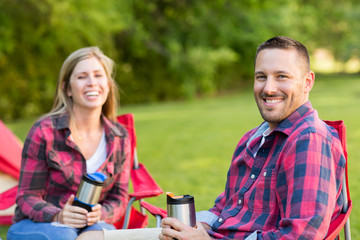 Couple talking and laughing on a camping trip.