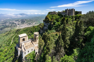 Beautiful panorama with two of the most famous landmark in Erice medieval town: Torretta Pepoli and Venus Castle, Sicily, Italy