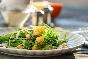 Fresh tasty salad on plate, closeup. Diet food