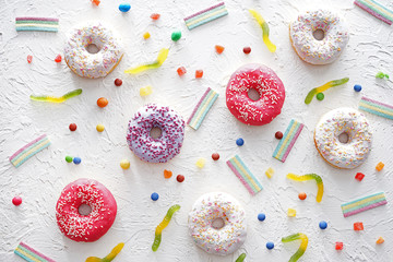 Tasty donuts and sweets on white background