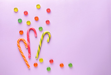 Composition with sweets on color background