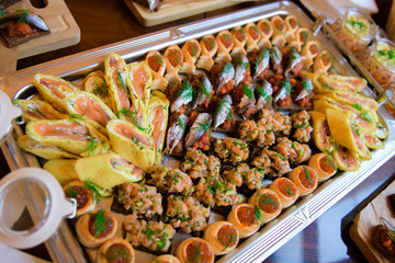 Varied food buffet table. The appetizers are exquisite for the reception.