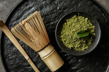 Composition with powdered matcha tea on tray