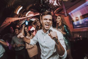 Sing in Karaoke. Men. Karaoke Club. Have Fun.