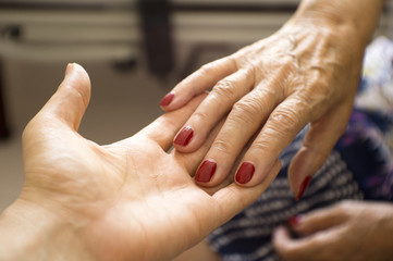 Hands of elderly person with senile dementia