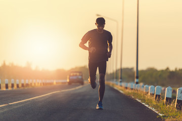 Athlete runner feet running on road Fototapete