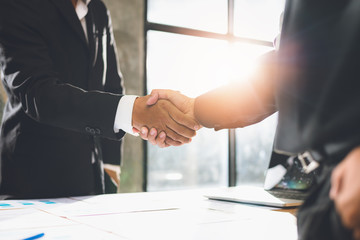 image of business people shaking hands,Negotiating businaess,Image of businessmen Handshaking