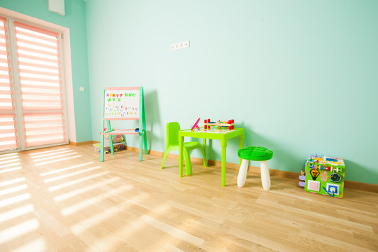 Modern playroom for children in pink and mint colours