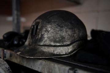 "A coal miner's helmet is put in the locker room of the mine ""La Escondida"" in Villablino"
