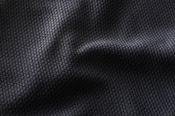 In de dag Stof Close-up polyester fabric texture of black athletic shirt