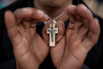 The Wider Image: For many migrants trekking to the U.S., faith is their compass