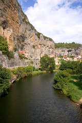 France, Quercy, Lot, quaint village houses built on the cliff above the River Cele at Cabrerets
