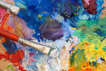 Artists oil paints and brushes multi coloured closeup