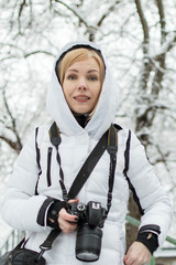 Woman photographer with a camera in the winter.