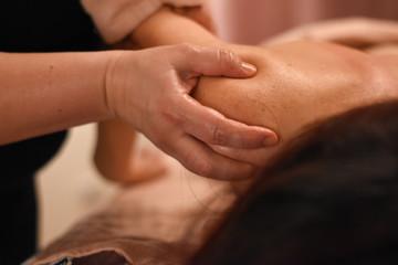 Woman having back massage. Body care, woman having massage in spa