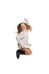 Cute little girl jump. Studio shot. White background. Kids fashion concept