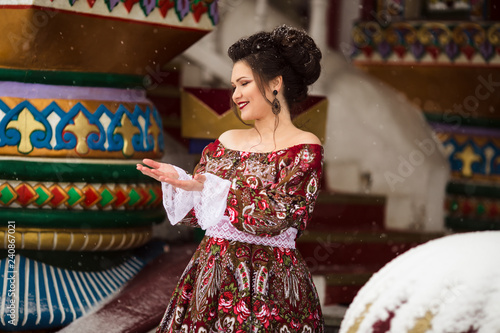 f47b06a6dedba Beautiful happy woman is wearing traditional russian clothes in winter park