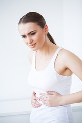 Stomach pain. Woman having painful stomachache,Female suffering from abdominal pain
