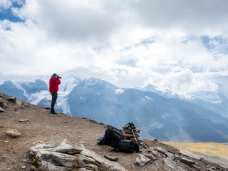 Italy, Trentino, Monte Cevedale, Punta San Matteo, hiker photographing