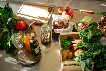 Fresh orgnaic vegetables and fruits in a kitchen