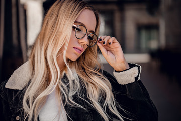 Beautiful blonde girl in stylish sunglassses outdoor