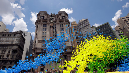 Balloons are released in the sky of downtown Sao Paulo as part of year-end celebrations, Sao Paulo