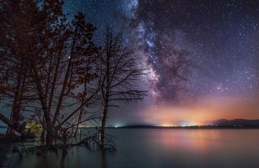 Milky way galaxy on the lake. Beautiful  night landscape. Fototapete