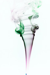 Colorful smoke of incence stick isolated at white background