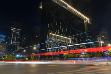 abstract image of blur motion of cars on the city road at night,Modern urban architecture in hangzhou, China