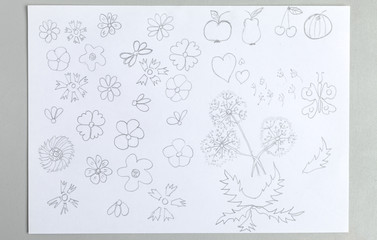 Kid drawings set of different flower heads fruits and butterfly.